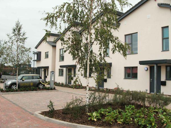 Il sistema integrato di Geothermal International per il complesso abitativo a zero emissioni di CO2 in d'Inghilterra